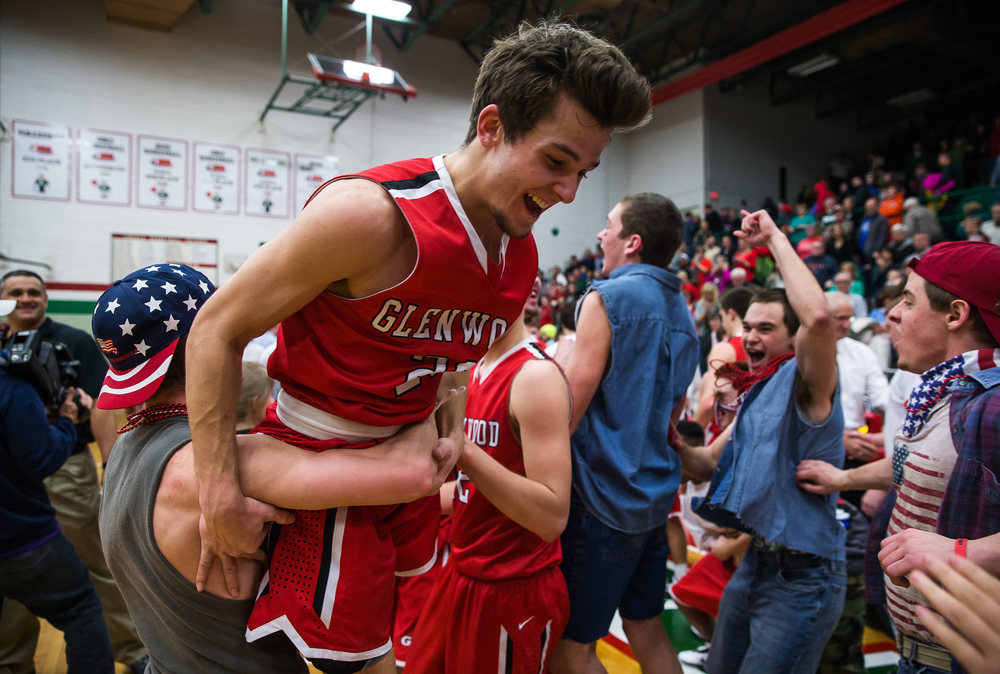 Glenwood junior Ethan Brill, left, hoists up Glenwood's Ethan Hunt (20) after the Titans defeated Lincoln 54-38 to claim the CS8 title at Roy S. Anderson Gymnasium, Friday, Feb. 27, 2015, in Lincoln, Ill. Hunt had seven threes and 21 points in the Titans victory. Justin L. Fowler/The State Journal-Register
