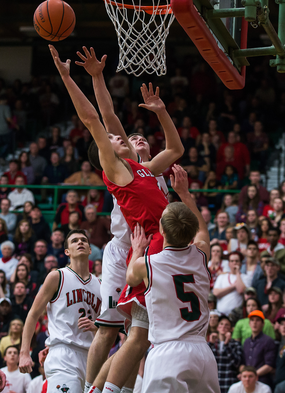 Glenwood's Joel Alexander (15) puts in a basket against Lincoln's Isaiah Bowers (33) in the second half at Roy S. Anderson Gymnasium, Friday, Feb. 27, 2015, in Lincoln, Ill. Justin L. Fowler/The State Journal-Register