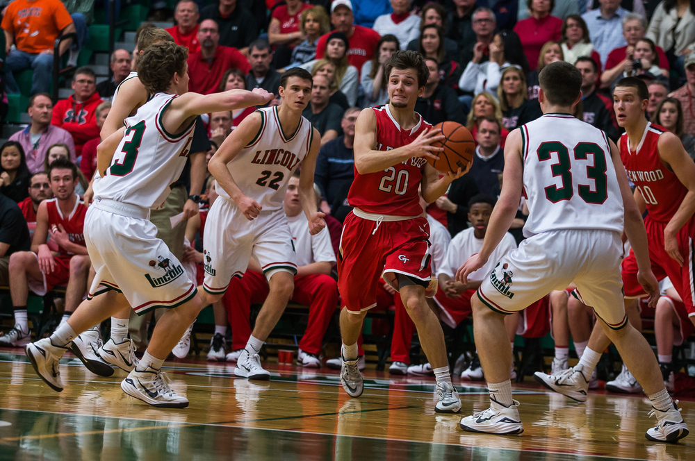 Glenwood's Ethan Hunt (20) draws in the defense from Lincoln before sending a pass in for Joel Alexander and a bucket in the second half at Roy S. Anderson Gymnasium, Friday, Feb. 27, 2015, in Lincoln, Ill. Justin L. Fowler/The State Journal-Register