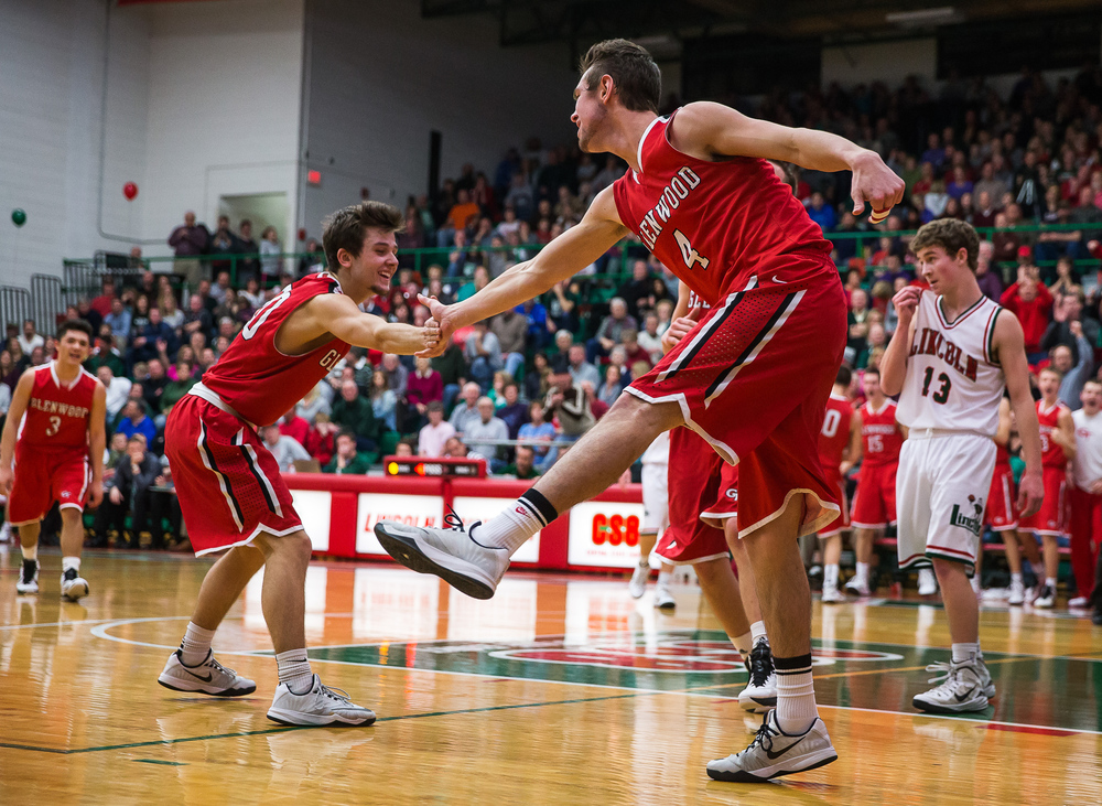 Glenwood's Sam Anderson (4) gets a high five from Ethan Hunt (20) after drawing a foul against Lincoln in the second half at Roy S. Anderson Gymnasium, Friday, Feb. 27, 2015, in Lincoln, Ill. Justin L. Fowler/The State Journal-Register