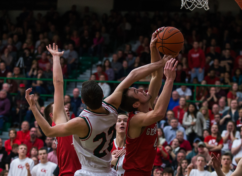 Lincoln's Gavin Block (22) is fouled by Glenwood's Sam Anderson (4) as he goes for a rebound in the second half at Roy S. Anderson Gymnasium, Friday, Feb. 27, 2015, in Lincoln, Ill. Justin L. Fowler/The State Journal-Register