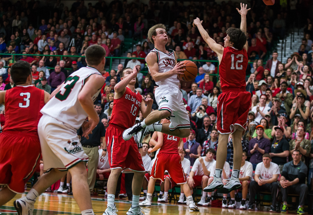Lincoln's Aron Hopp (5) floats through the air as he tries to put in a basket against Glenwood's Nick Hammond (12) in the first half at Roy S. Anderson Gymnasium, Friday, Feb. 27, 2015, in Lincoln, Ill. Justin L. Fowler/The State Journal-Register