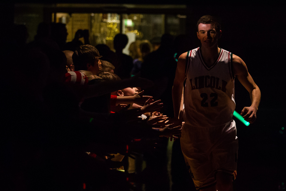 Lincoln's Gavin Block (22) is introduced under the spotlight during player introductions prior to taking on Glenwood at Roy S. Anderson Gymnasium, Friday, Feb. 27, 2015, in Lincoln, Ill. Justin L. Fowler/The State Journal-Register