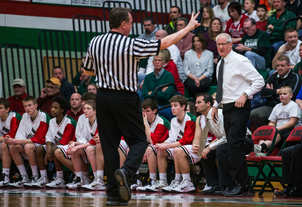 Lincoln head basketball coach Neil Alexander disagrees with a foul call against Lincoln as they take on Glenwood in the first half at Roy S. Anderson Gymnasium, Friday, Feb. 27, 2015, in Lincoln, Ill. Justin L. Fowler/The State Journal-Register