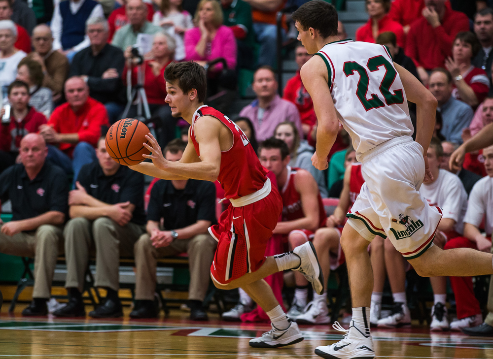 Glenwood's Ethan Hunt (20) accelerates as he moves the ball up court against Lincoln's Gavin Block (22) in the first half at Roy S. Anderson Gymnasium, Friday, Feb. 27, 2015, in Lincoln, Ill. Justin L. Fowler/The State Journal-Register