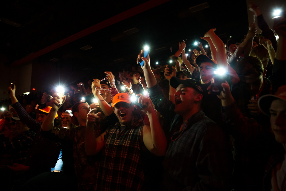 The Glenwood student section illuminate themselves with the flashlight on their cell phones during player introductions prior to Lincoln taking on Glenwood at Roy S. Anderson Gymnasium, Friday, Feb. 27, 2015, in Lincoln, Ill. Justin L. Fowler/The State Journal-Register