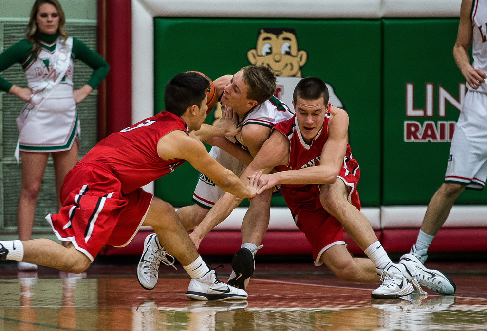 Glenwood's Cole Harper (10) collides with Lincoln's Aron Hopp (5) as they go for a loose ball in the first half at Roy S. Anderson Gymnasium, Friday, Feb. 27, 2015, in Lincoln, Ill. Justin L. Fowler/The State Journal-Register