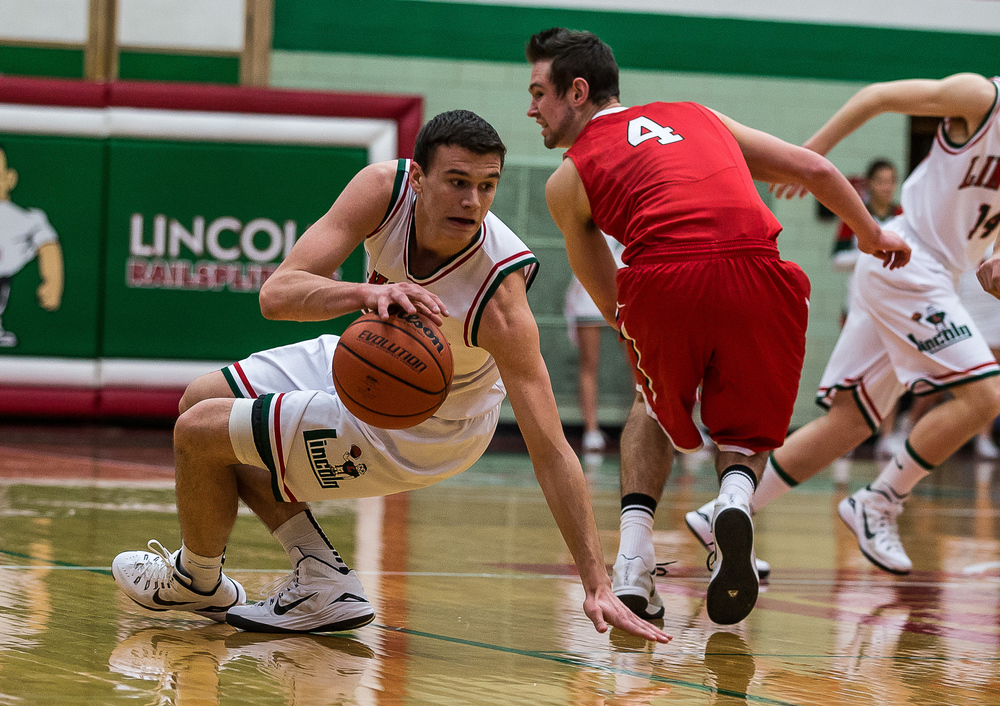 Lincoln's Gavin Block (22) regains possession of the ball after nearly loosing it to Glenwood's Sam Anderson (4) on a botched pass in the first half at Roy S. Anderson Gymnasium, Friday, Feb. 27, 2015, in Lincoln, Ill. Justin L. Fowler/The State Journal-Register