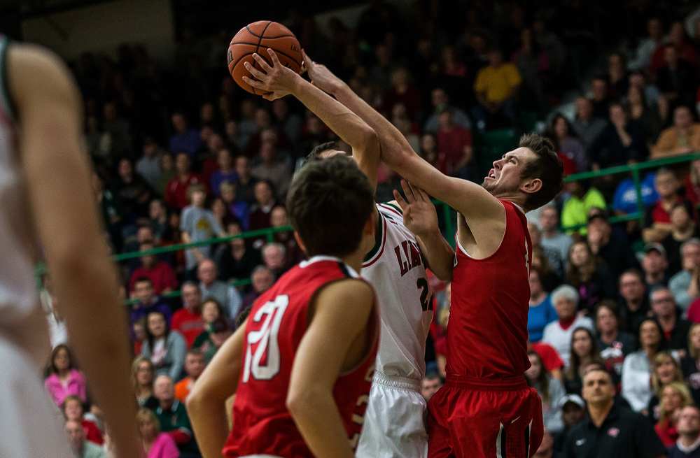 Glenwood's Sam Anderson (4) blocks a shot from Lincoln's Gavin Block (22) in the first half at Roy S. Anderson Gymnasium, Friday, Feb. 27, 2015, in Lincoln, Ill. Justin L. Fowler/The State Journal-Register