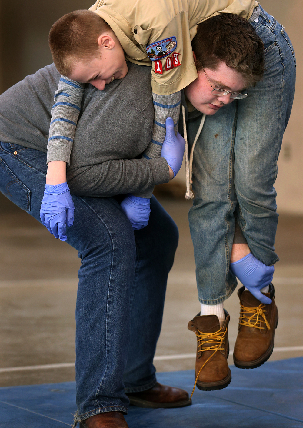 Boy Scout Troop #103 of Jacksonville member John Paul Killam performs a Fireman's Carry on fellow troop member Gavin Gass in a training scenario in which different victim carrying techniques were practiced. David Spencer/The State Journal Register