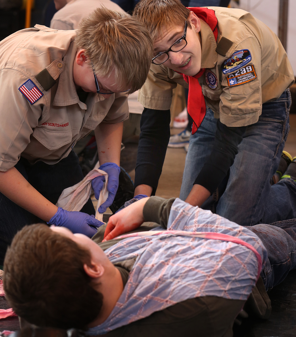 Athens Troop #52 members Logan Daniels at right and Owen Iocca keep talking with victim Zachary Homeier who was injured in a climbing accident. David Spencer/The State Journal Register