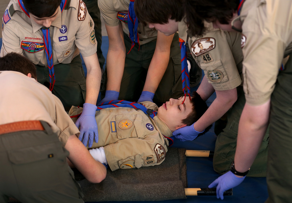 Chatham Troop #48 member Connor Barham prepares to be lifted by his fellow troop mates onto a stretcher during a scenario where the scouts learned various moving techniques.  David Spencer/The State Journal Register
