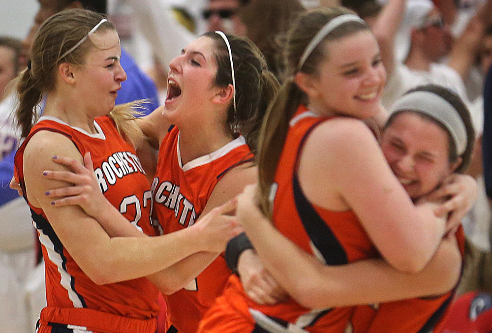 Rochester's Meagan McNicholas, left and Laryn Sapetti embrace and celebrate along with their teammates seconds after winning the game. Rochester High School defeated Metropolis Massac County 39-35 