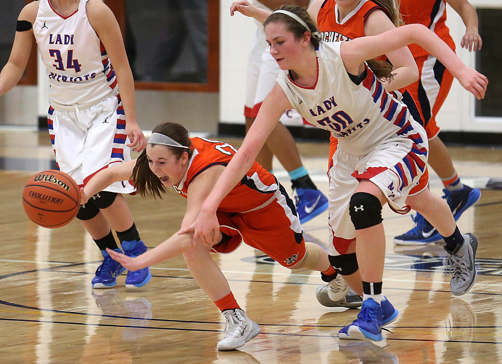 Rochester player Aubrey Magro and Massac's Jessica Coakley go after a loose ball. Rochester High School defeated Metropolis Massac County 39-35 