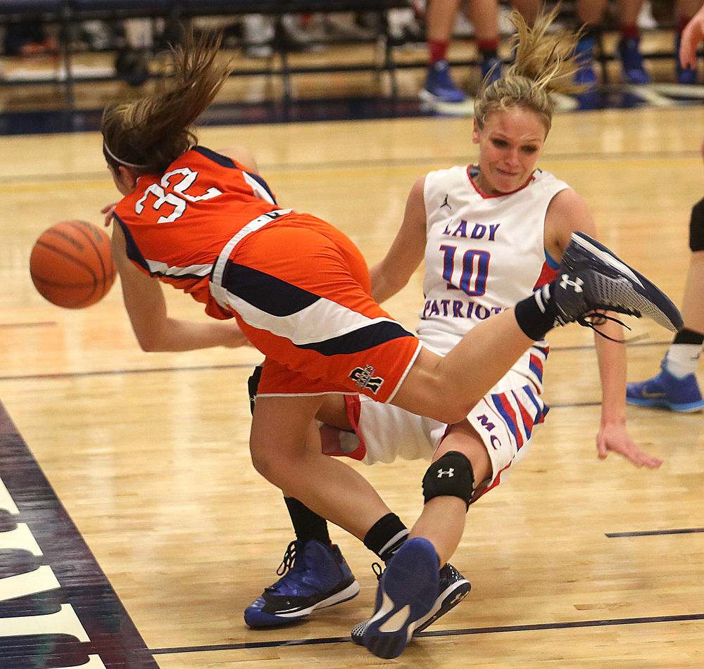 Rochester's Laryn Sapetti and Massac player Jessie Douglas get tangled up during first half action. Rochester High School defeated Metropolis Massac County 39-35 