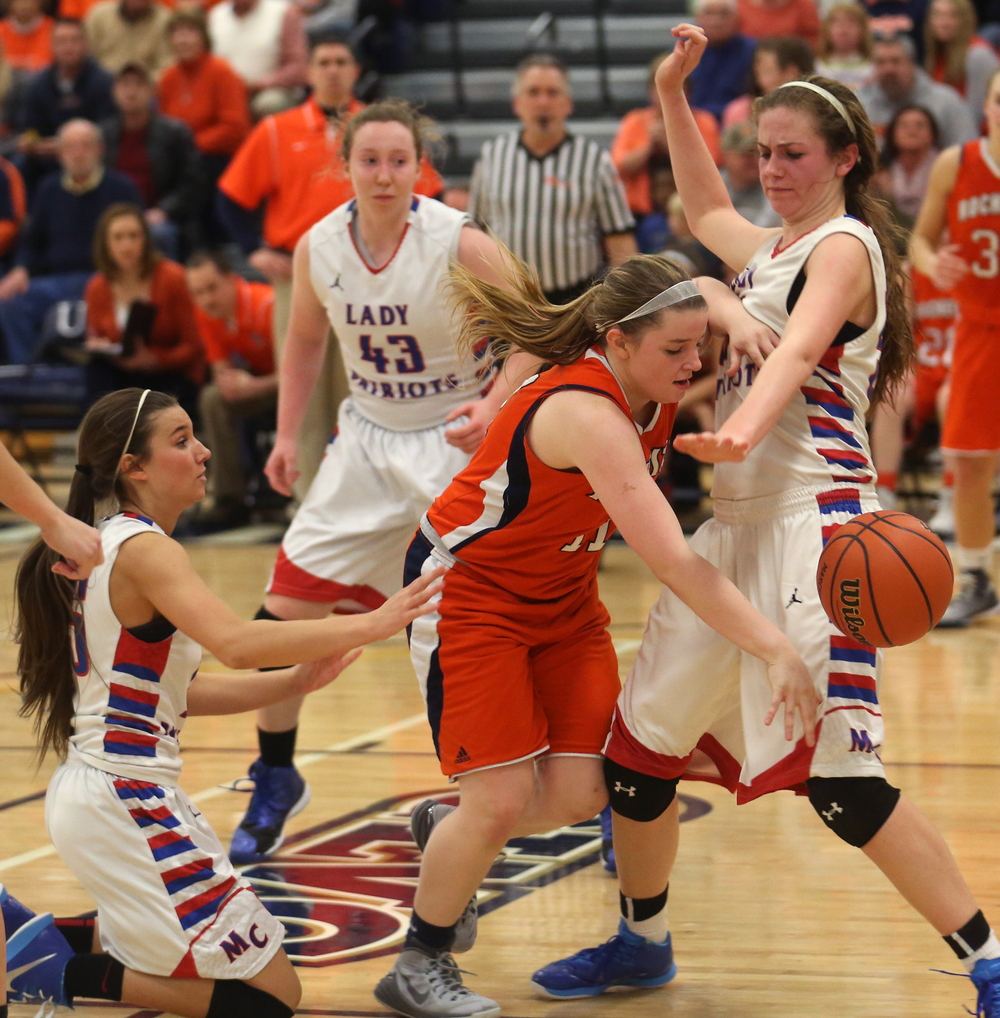 Rochester player Kylie Clemens goes after a loose ball under pressure from Massac. Rochester High School defeated Metropolis Massac County 39-35 