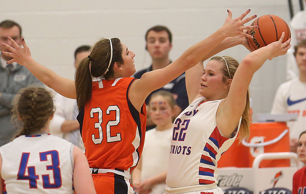 Massac player Graycyn McBride loods to pass around Rochester's Laryn Sapetti. Rochester High School defeated Metropolis Massac County 39-35 