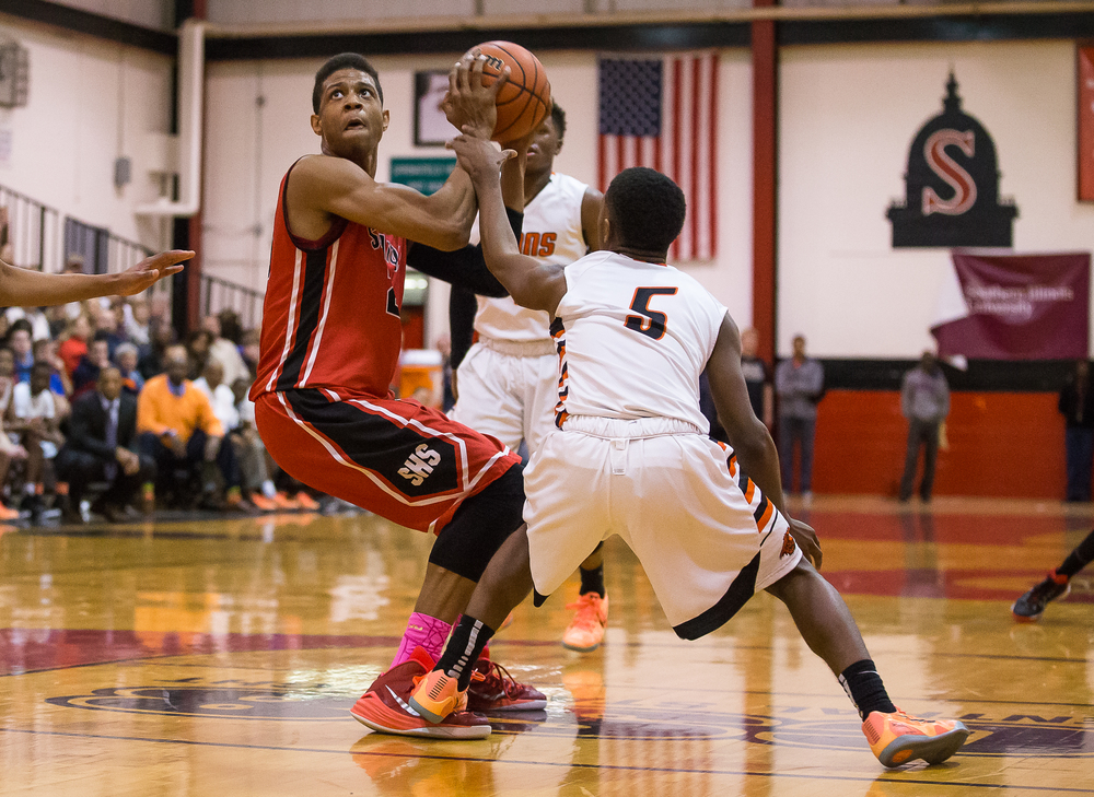 Lanphier's Xavier Bishop (5) steps on the foot of Springfield's Obediah Church (23) while slapping his arm drawing his fifth foul of the game in the second half during the Class 3A Springfield Regional at Willard Duey Gymnasium, Tuesday, March 3, 2015, in Springfield, Ill. Justin L. Fowler/The State Journal-Register