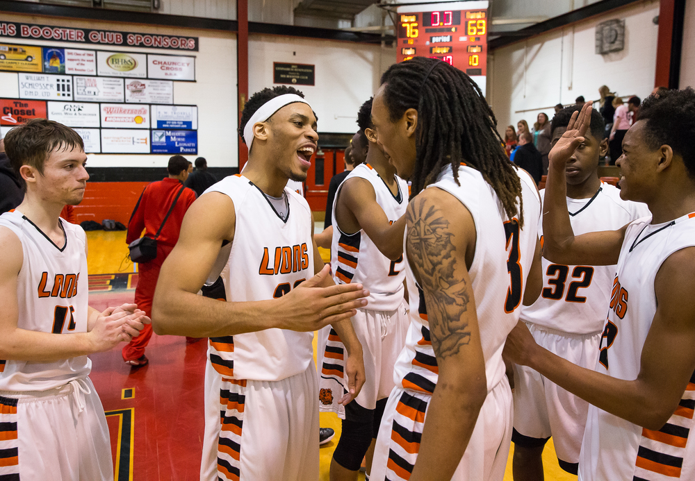 Lanphier's Daryl Jackson (22) and Aarin Thames (3) celebrate with the Lions after their 76-69 victory over Springfield during the Class 3A Springfield Regional at Willard Duey Gymnasium, Tuesday, March 3, 2015, in Springfield, Ill. Justin L. Fowler/The State Journal-Register