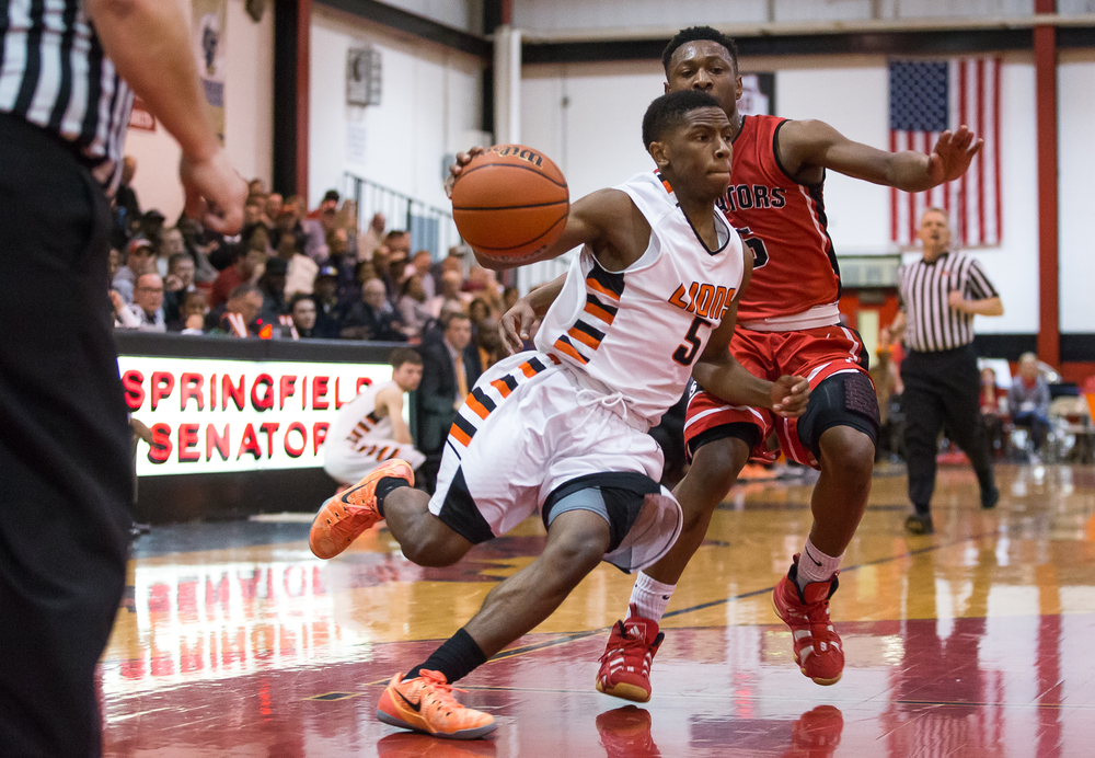 Lanphier's Xavier Bishop (5) accelerates past Springfield's Isaac Nelson (5) as he drives to the basket in the first half during the Class 3A Springfield Regional at Willard Duey Gymnasium, Tuesday, March 3, 2015, in Springfield, Ill. Justin L. Fowler/The State Journal-Register