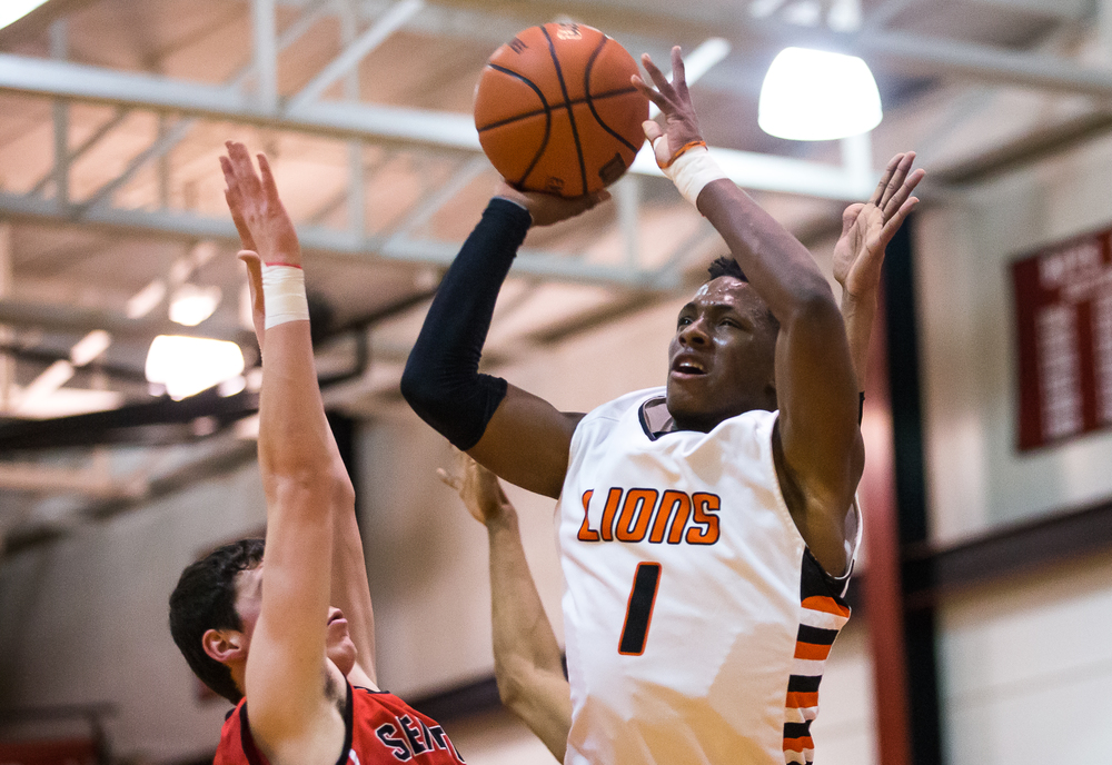 Lanphier's Yaakema Rose (1) goes up for a shot against Springfield's Trevor Minder (15) in the first half during the Class 3A Springfield Regional at Willard Duey Gymnasium, Tuesday, March 3, 2015, in Springfield, Ill. Justin L. Fowler/The State Journal-Register
