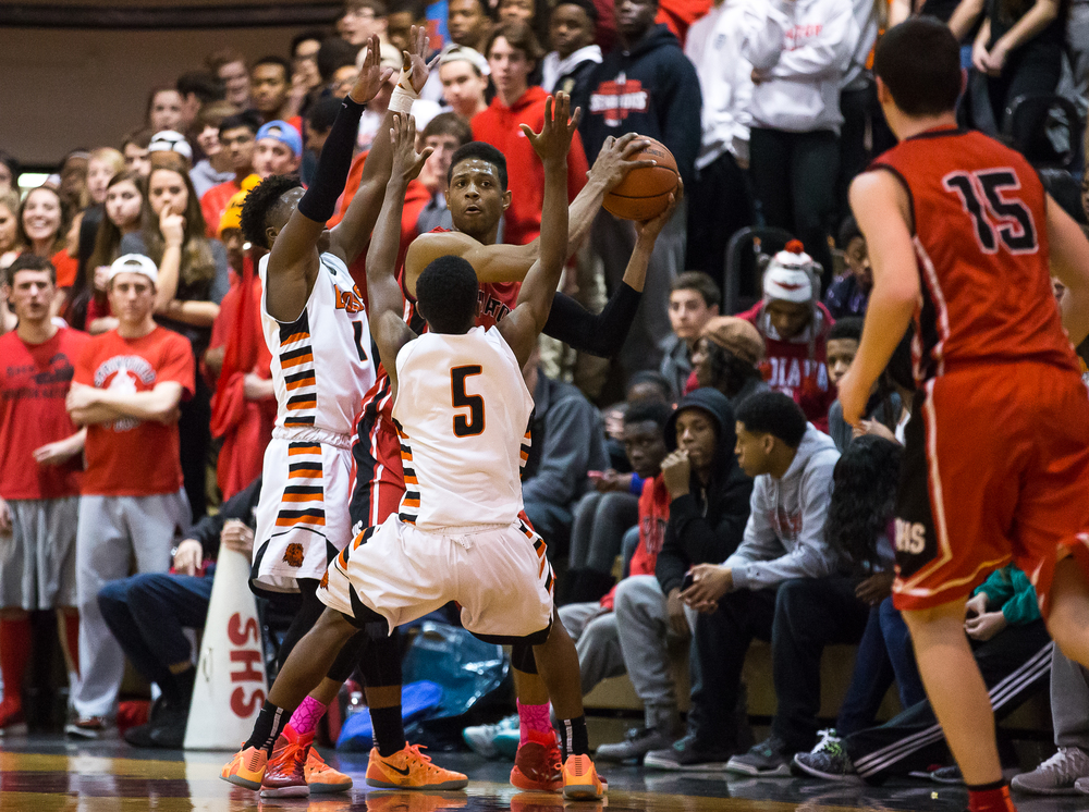 Springfield's Obediah Church (23) is swarmed by Lanphier's Xavier Bishop (5) and Yaakema Rose (1) in the first half during the Class 3A Springfield Regional at Willard Duey Gymnasium, Tuesday, March 3, 2015, in Springfield, Ill. Justin L. Fowler/The State Journal-Register