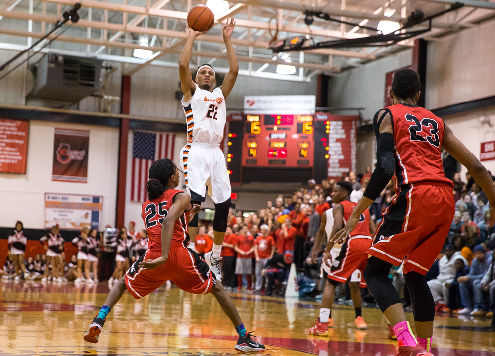 Lanphier's Daryl Jackson (22) shoots a jumper against Springfield in the first half during the Class 3A Springfield Regional at Willard Duey Gymnasium, Tuesday, March 3, 2015, in Springfield, Ill. Justin L. Fowler/The State Journal-Register