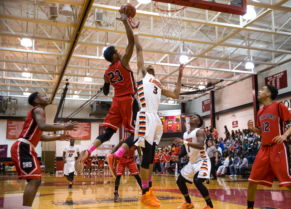 Springfield's Obediah Church (23) swats a rebound away from Lanphier's Aarin Thames (3) in the first half during the Class 3A Springfield Regional at Willard Duey Gymnasium, Tuesday, March 3, 2015, in Springfield, Ill. Justin L. Fowler/The State Journal-Register