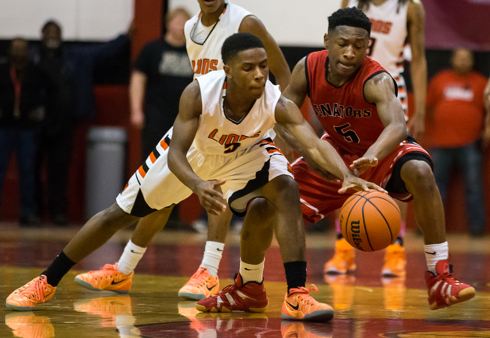 Lanphier's Xavier Bishop (5) wins a loose ball against Springfield's Isaac Nelson (5) in the second half during the Class 3A Springfield Regional at Willard Duey Gymnasium, Tuesday, March 3, 2015, in Springfield, Ill. Justin L. Fowler/The State Journal-Register