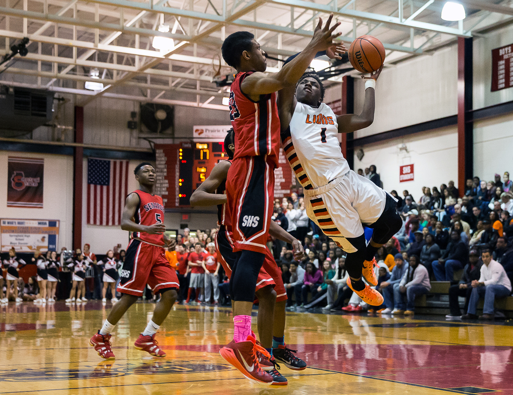 Lanphier's Yaakema Rose (1) draws the foul from Springfield's Obediah Church (23) as he drives up to the basket in the first half during the Class 3A Springfield Regional at Willard Duey Gymnasium, Tuesday, March 3, 2015, in Springfield, Ill. Justin L. Fowler/The State Journal-Register
