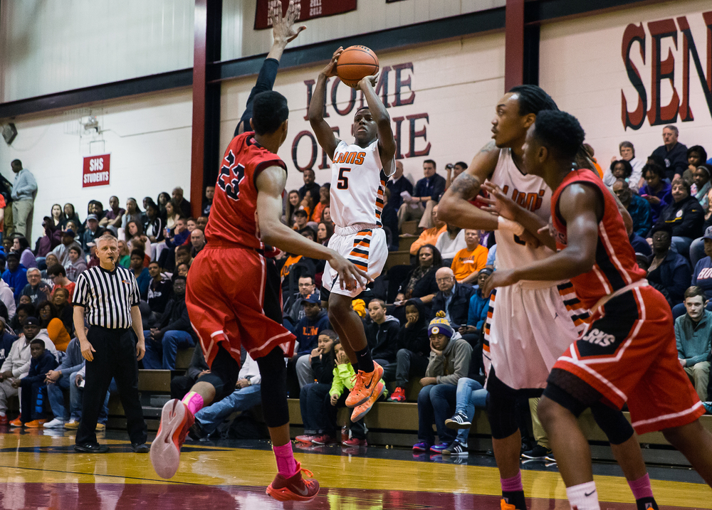 Lanphier's Xavier Bishop (5) fires a jumper over Springfield's Obediah Church (23) in the first half during the Class 3A Springfield Regional at Willard Duey Gymnasium, Tuesday, March 3, 2015, in Springfield, Ill. Justin L. Fowler/The State Journal-Register