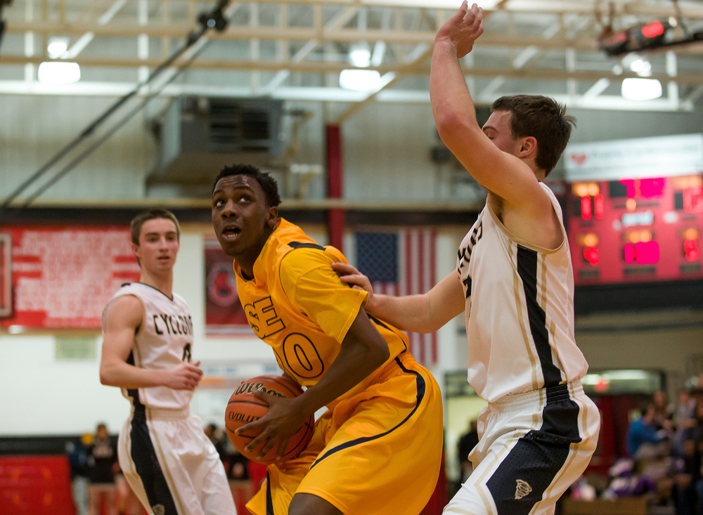 Southeast's D'Angelo Hughes (30) posts up against Sacred Heart-Griffin's Gabe Green (3) as he goes for a shot in the first half during the Class 3A Springfield Regional at Willard Duey Gymnasium, Wednesday, March 4, 2015, in Springfield, Ill. Justin L. Fowler/The State Journal-Register