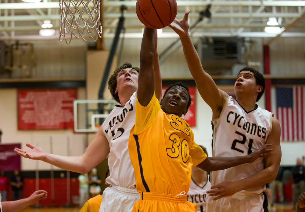 Southeast's D'Angelo Hughes (30) wins a rebound underneath the basket against Sacred Heart-Griffin's Michael Zeigler (15) and in the second half during the Class 3A Springfield Regional at Willard Duey Gymnasium, Wednesday, March 4, 2015, in Springfield, Ill. Justin L. Fowler/The State Journal-Register