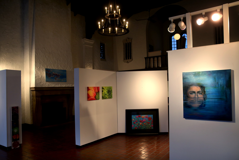 An acyrlic/oil painting by Pharmacy artist Diane Schleyhahn at right greets visitors to the main exhibition space featuring member work hung on moveable white panels lit by new spotlights and an original chandelier above.David Spencer/The State Journal Register