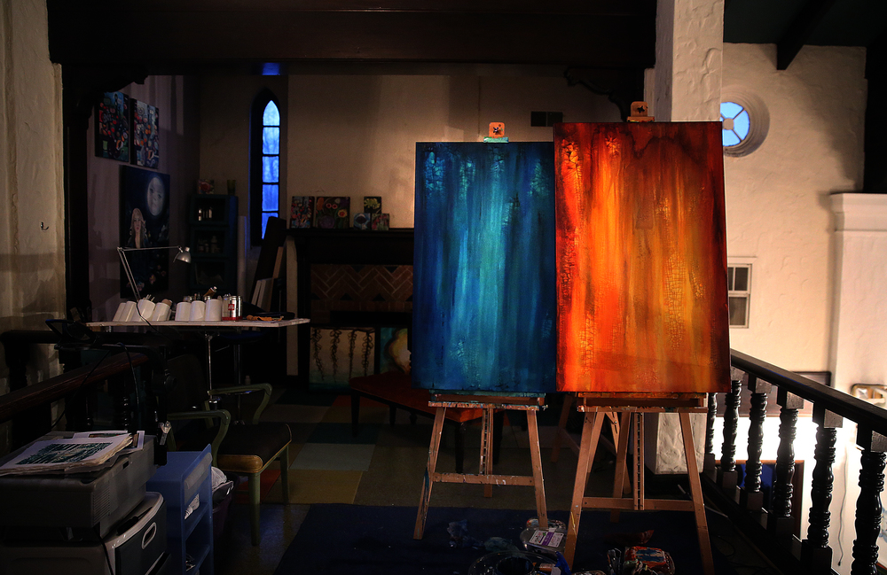 In the balcony area used as individual artist studio space, paintings in progress by Pharmacy artist Jeff Williams each take up an easel. David Spencer/The State Journal Register