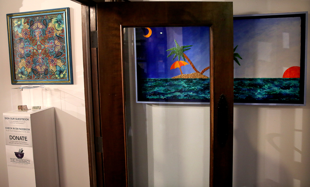 In the front entryway, a painting by Pharmacy artist David Balmer is at right and a work by Wendy Allen is hung above a donation box. David Spencer/The State Journal Register