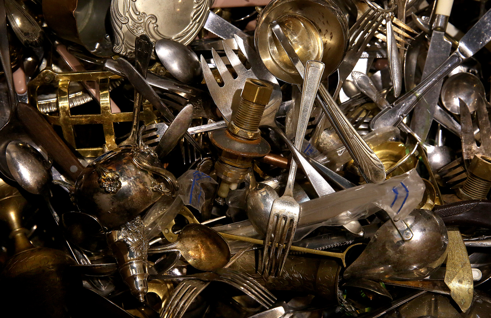 No gold bars spotted, but thousands of items fashioned out of metal, including many forks of all shapes and sizes, are collected in one oversized box that eventually will be recycled and sold to a third party vendor.David Spencer/The State Journal Register