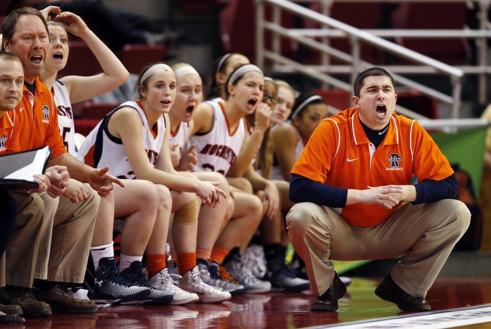 Rochester's head coach J.R. Boudouris and the Rockets react to the action on the floor against Chicago Bogan during the Class 3A state tournament semifinal at Redbird Arena in Normal Friday, March 6, 2015. Ted Schurter/The State Journal-Register