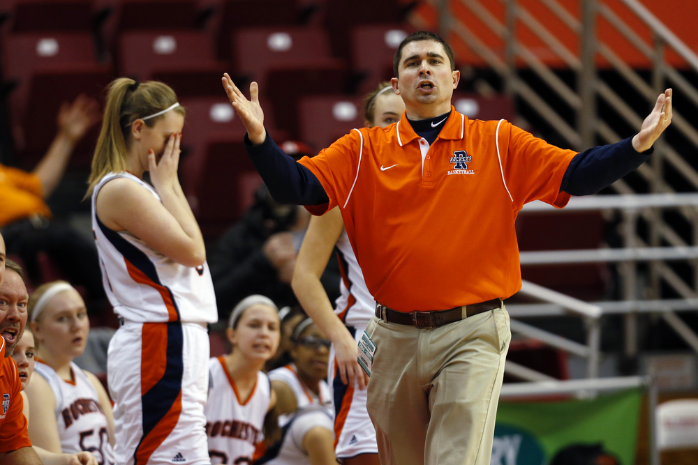 Rochester head coach J.R. Boudouris is incredulous a charge wasn't called during a play against Chicago Bogan that left Lyric Boone face down on the floor during the Class 3A state tournament semifinal at Redbird Arena in Normal Friday, March 6, 2015. Ted Schurter/The State Journal-Register
