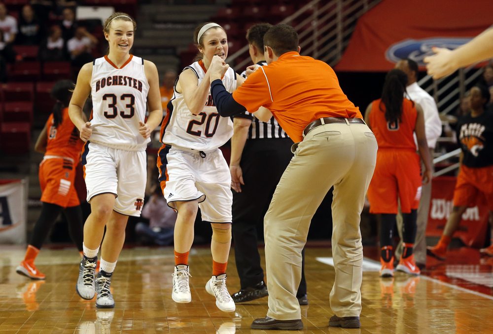 Rochester's Aubrey Magro greets head coach J.R. Boudouris after draining a three-pointer to put the Rockets up by ten to end the third quarter against Chicago Bogan during the Class 3A state tournament semifinal at Redbird Arena in Normal Friday, March 6, 2015. Magro ended with nine points in 14 minutes. Ted Schurter/The State Journal-Register