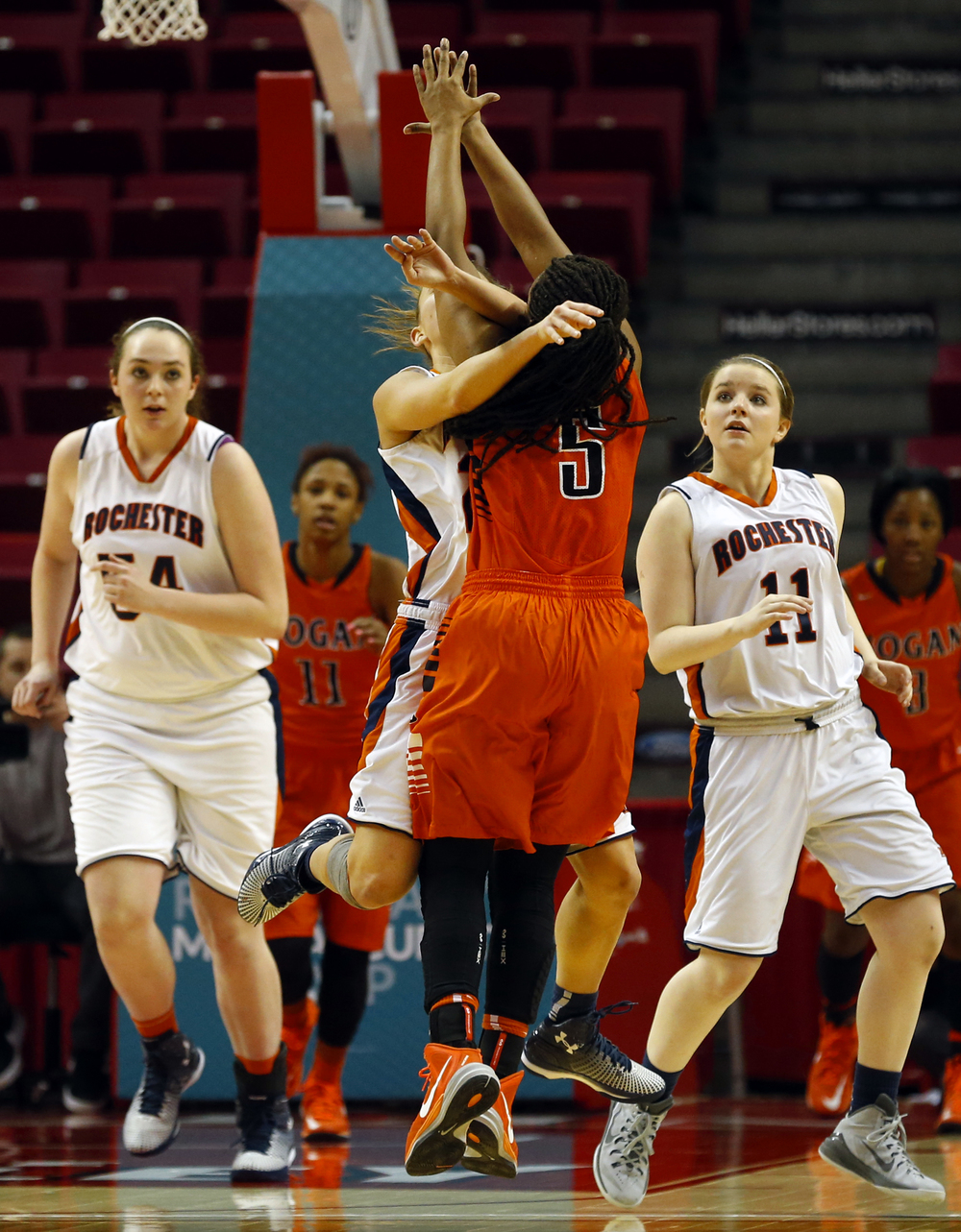 Rochester's Sydney Lett collides with Chicago Bogan's Deja Dickens as she unleashes a shot during the Class 3A state tournament semifinal at Redbird Arena in Normal Friday, March 6, 2015. Ted Schurter/The State Journal-Register