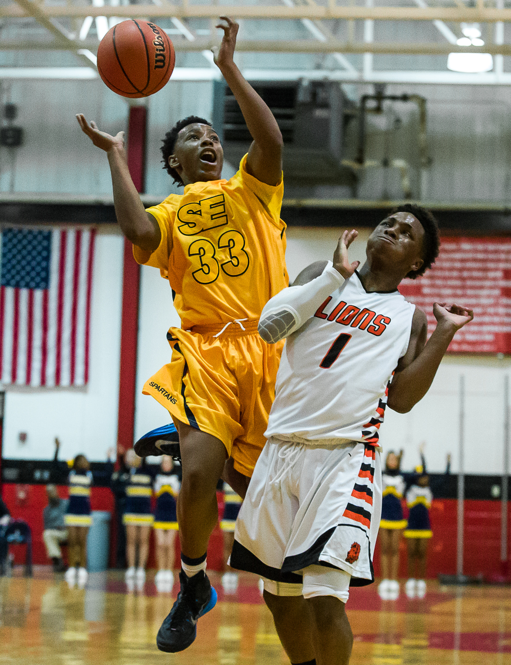 Lanphier's Yaakema Rose (1) picks up his third foul as Southeast's Mark Johnson (33) tries to go up for a shot in the first half during the Class 3A Springfield Regional title game at the Willard Duey Gymnasium, Friday, March 6, 2015, in Springfield, Ill. Justin L. Fowler/The State Journal-Register
