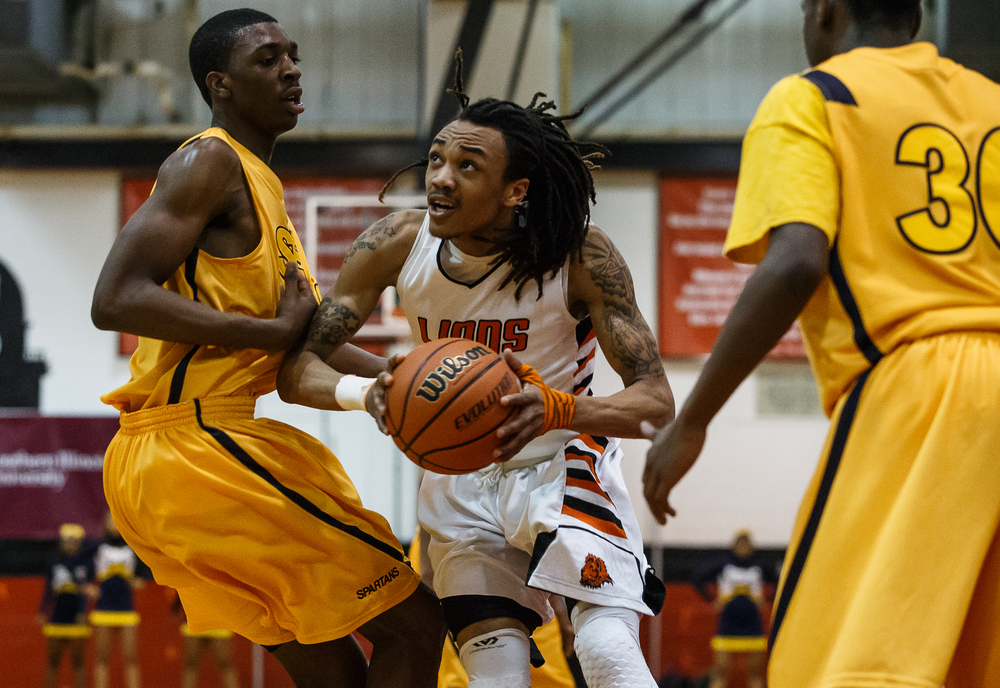 Lanphier's Aarin Thames (3) goes up to the basket as he works around Southeast's Darius Ousley (43) in the second half during the Class 3A Springfield Regional title game at the Willard Duey Gymnasium, Friday, March 6, 2015, in Springfield, Ill. Justin L. Fowler/The State Journal-Register