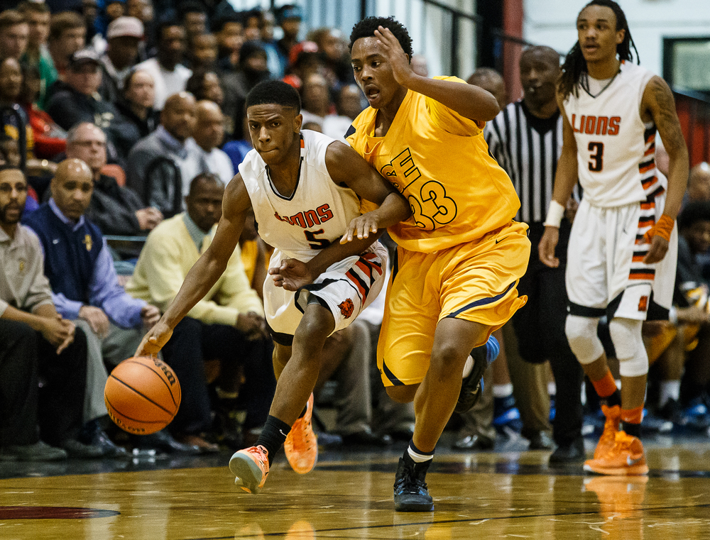 Lanphier's Xavier Bishop (5) pushes the ball up court against Southeast's Mark Johnson (33) in the second half during the Class 3A Springfield Regional title game at the Willard Duey Gymnasium, Friday, March 6, 2015, in Springfield, Ill. Justin L. Fowler/The State Journal-Register