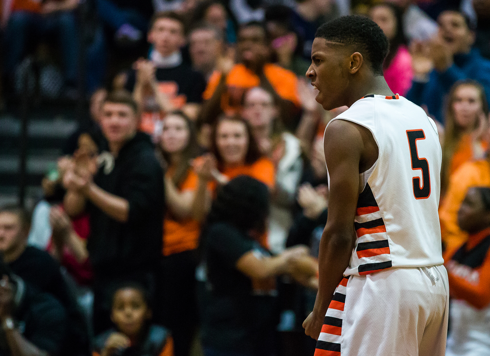 Lanphier's Xavier Bishop (5) reacts after drawing the foul while shooting a basket against Southeast in the second half during the Class 3A Springfield Regional title game at the Willard Duey Gymnasium, Friday, March 6, 2015, in Springfield, Ill. Justin L. Fowler/The State Journal-Register