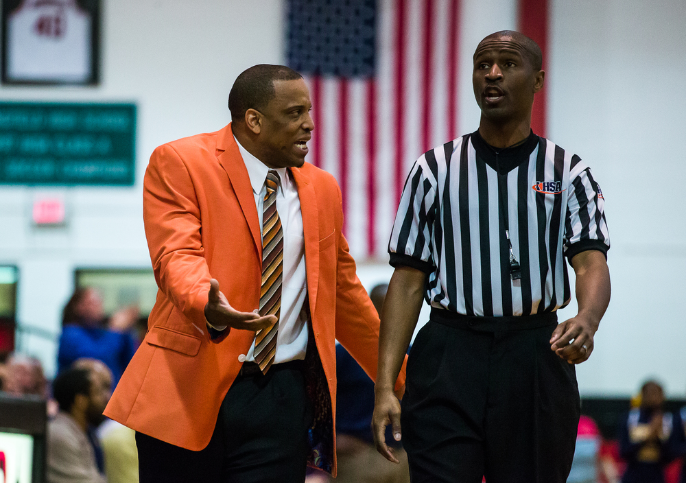 Lanphier head coach Blake Turner argues a foul call against the Lions with a referee as they take on Southeast in the second half during the Class 3A Springfield Regional title game at the Willard Duey Gymnasium, Friday, March 6, 2015, in Springfield, Ill. Justin L. Fowler/The State Journal-Register