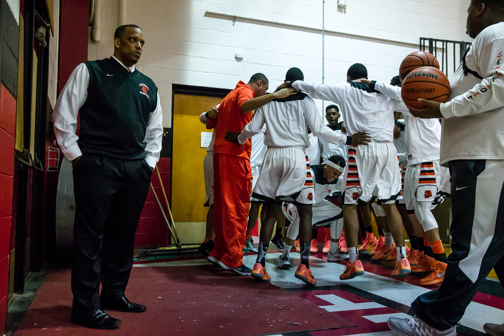 Lanphier head coach Blake Turner waits by his team as the Lions get prepared to take on Southeast in the Class 3A Springfield Regional title game at the Willard Duey Gymnasium, Friday, March 6, 2015, in Springfield, Ill. Justin L. Fowler/The State Journal-Register