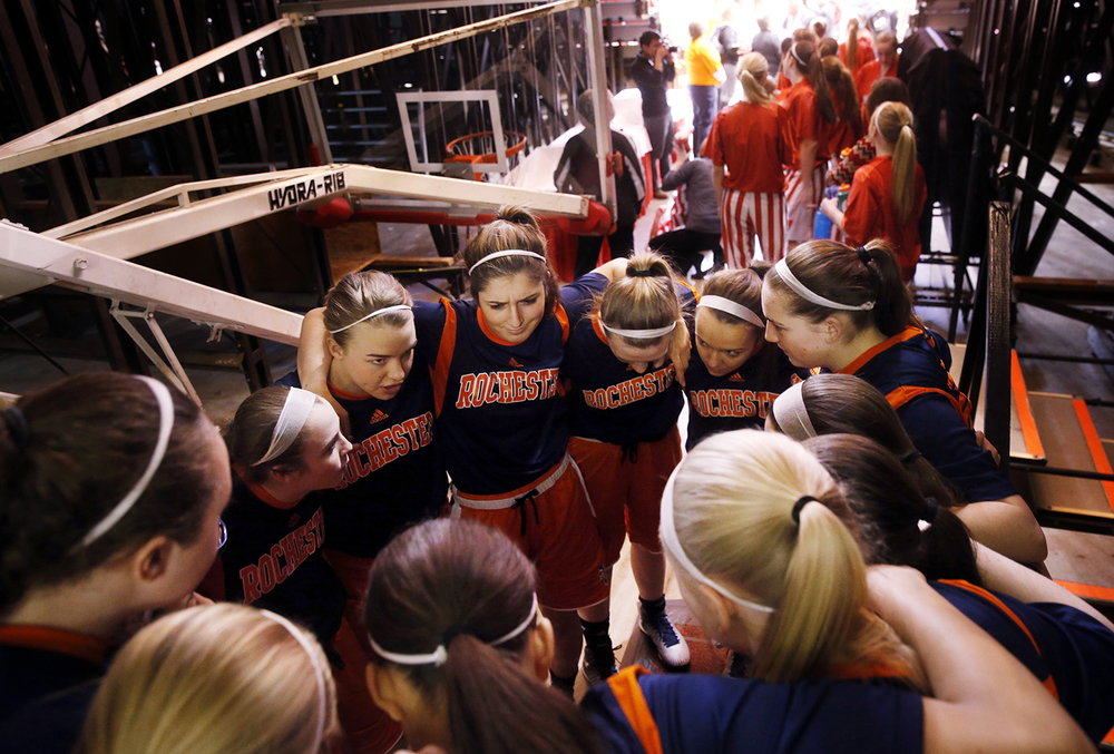 The Rochester Rockets huddle up under the bleachers before facing Morton during the Class 3A state championship at Redbird Arena in Normal Saturday, March 7, 2015. Ted Schurter/The State Journal-Register