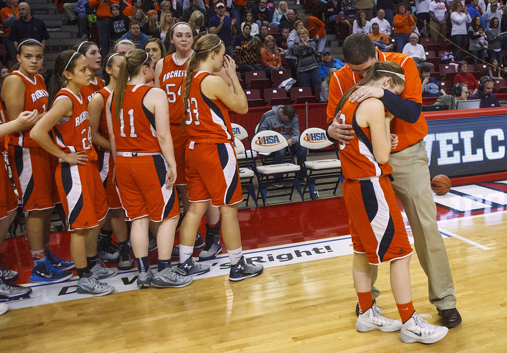 Rochester head coach J.R. Boudouris consoles Aubrey Magro after the Rockets lost to Morton during the Girls 3A State Championship game at Redbird Arena Saturday, March 7, 2015. Ted Schurter/The State Journal-Register