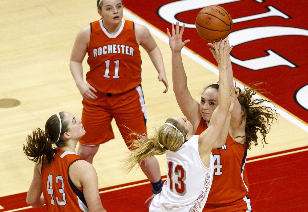 Morton's Brandi Bisping plows into Rochester's Angela Perry as she shoots in the lane during the Girls 3A State Championship game at Redbird Arena Saturday, March 7, 2015. Ted Schurter/The State Journal-Register